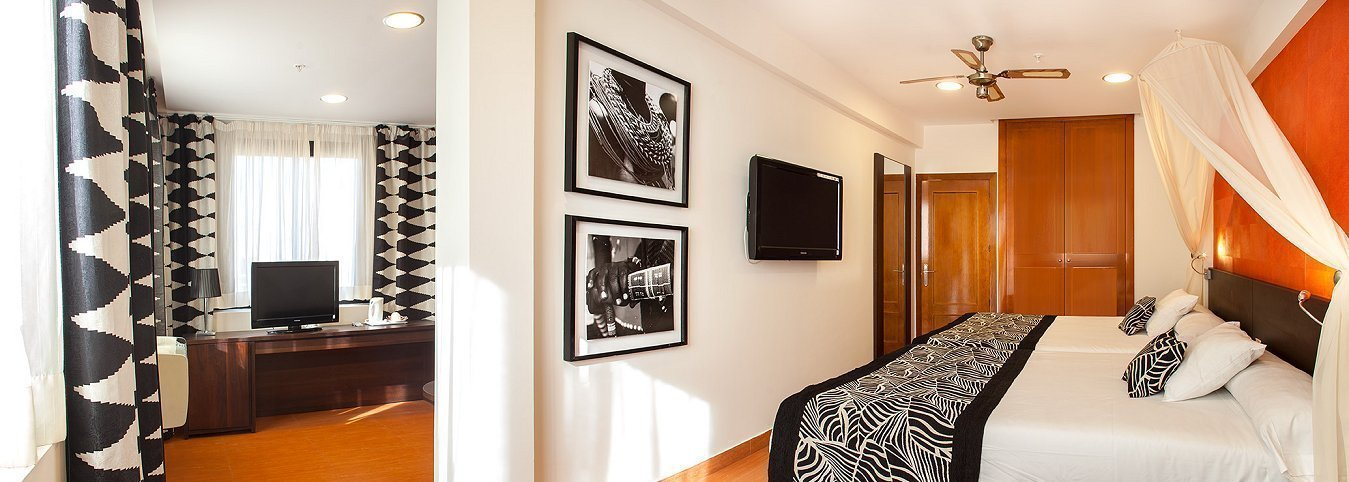 Habitación con salón tematizado Отель Magic Aqua™ Rock Gardens